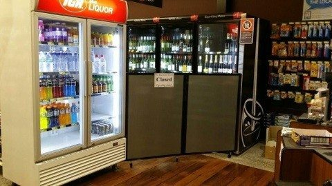 Custom Screen in gray polycabonate used to section off bottle shop area
