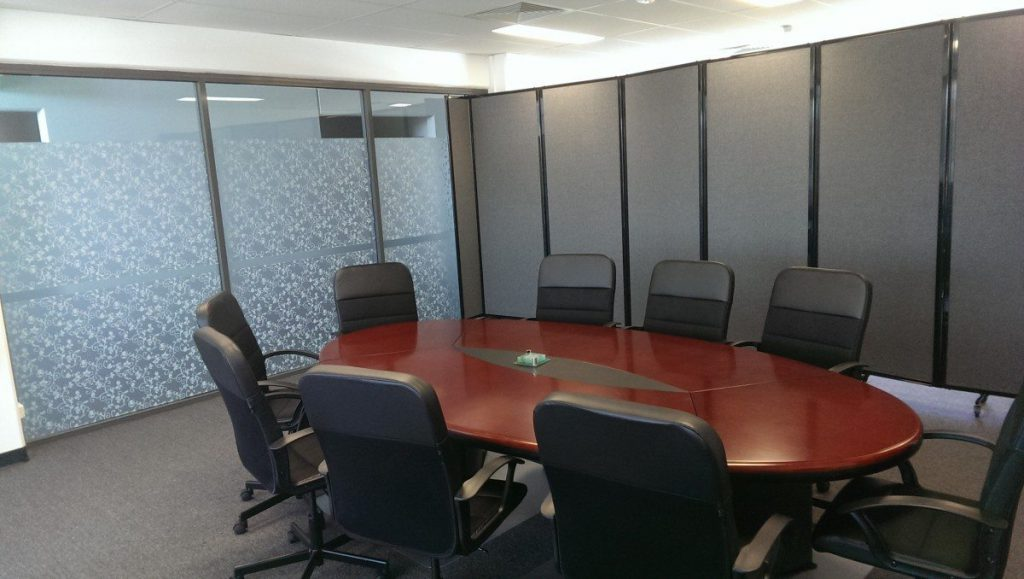 Gray Office Partition used to create meeting room with boardroom table - Portable Partitions