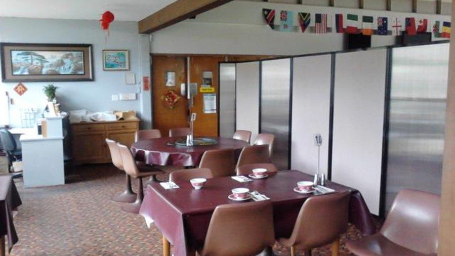 Restaurant with partition separating dining area - Portable Partitions