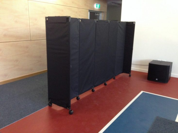 Basic black canvas screen MP10 on edge of school basketball court - Portable Partitions