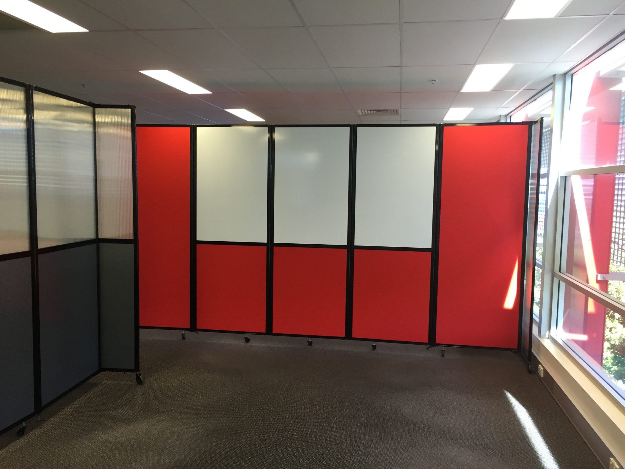 Red custom temporary wall with whiteboard for workstation - Portable Partitions