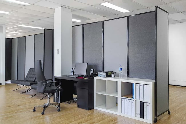 Two connected Charcoal and Grey 360 Degree Portable Room Divider in office